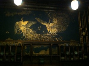 Image of two peacock's fighting exhibited in the peacock room (image by Kadie Aaron)