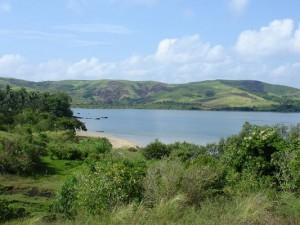 Beautiful Landscape of Nature, the Peaceful Sea, Green Hills All Around, is Impressive Scene. By Chavez Joseph via Free Wallpaper World