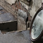 Old Mirror Standing Against Wall, Image Creator: Unknown, Mirrors in History