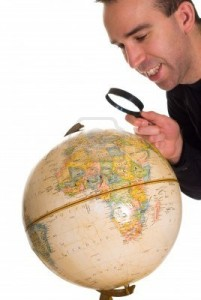 """A Man Looking at the Globe to Find the Town He Lives In"", Creator: Richard Nelson, 123rf.com"