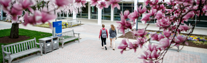Two Students Walking in Rowley Courtyard