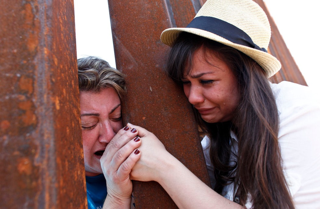 Renata Teodoro and her mother, Gorete Borges Teodoro, meet at Mexico Border Fence after being deported in 2007 (Samantha Sais for New York Times).