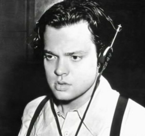 Image of Orson Welles shown performing his radio program